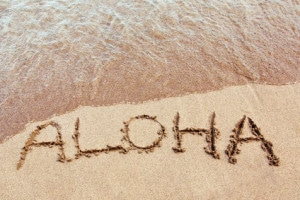aloha written in the sand on a Hawaiian beach